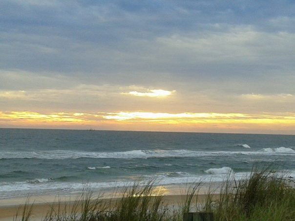 Image of sunrise over ocean by Lyn Janssen