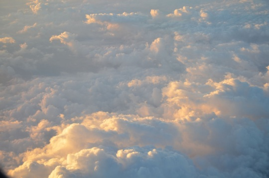 image of Sun shining on clouds from above